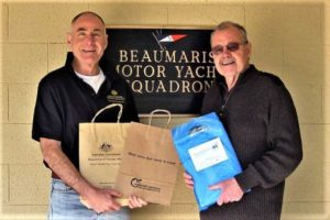 Alan White and Ross Popplewell with men's health showbags at Beaumaris Motor Yacht Squadron