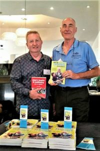 Greg Millan and Alan White holding their books